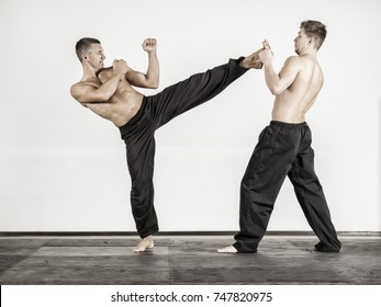 An image of two fighting sports men