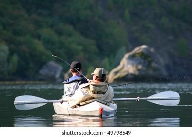 An image of two men in a boat