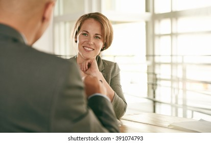 Image of two succesful business people conducting an interview to hire their next employee