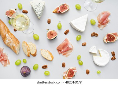 image of two wine glasses and snacks