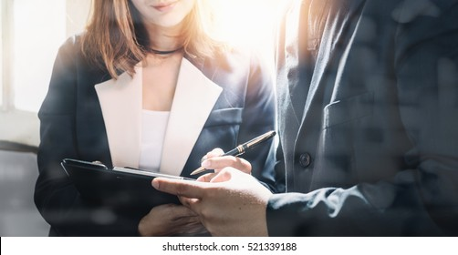 Image of two young business people talking at meeting