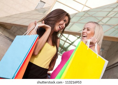 Image of a two young women with shopping bags
