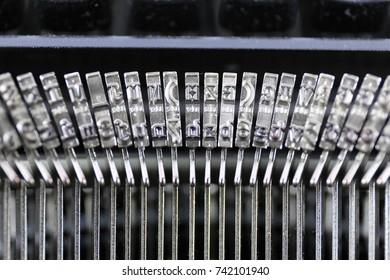 An Image of a typewriter letter - typebar