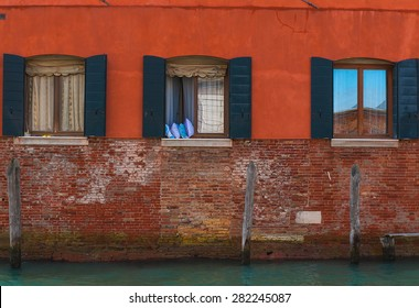 Image of typical venetian house facade and windows, Italy.