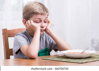 Image of unhappy fussy eater during dinner