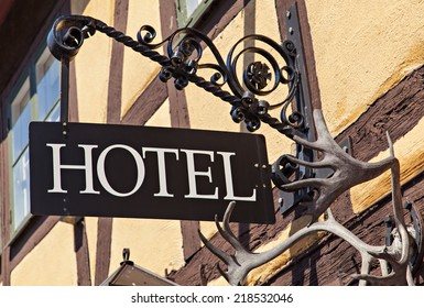 Image of unique old metal hotel sign