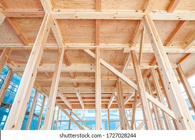 Image of the upper building of a new wooden house under construction