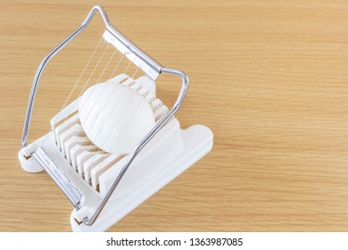 Image of using egg slicer
