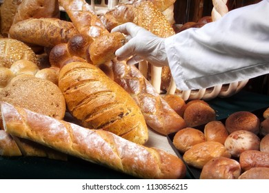 an image of variety of breads and chief