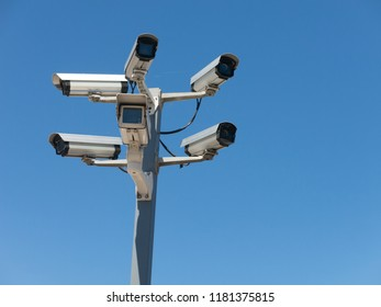 Image with various video surveillance cameras. Six cctv security cameras on the street pylon. Security cameras mounting on the high top position