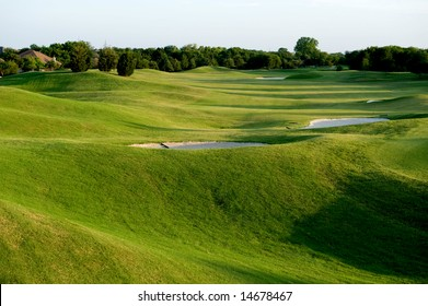 An image of a vibrant green golf course