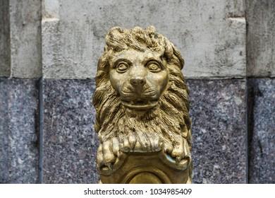Image of a vintage gold lion sculpture made of metal