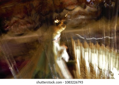 image of the Virgin in the procession of Holy Week in Toledo 2018, Spain,Impressionist artistic photograph  with controlled movements of the camera to suggest emotion,