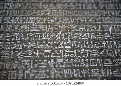image of a wall with hieroglyphs, rosetta stone