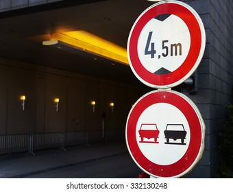 An image of a warning sign telling that the tunnel is 4,5 meters high and passing by is prohibited. The warning signs has been composed to the right side of the image. Image has a vintage effect.
