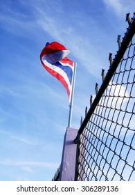 Image of waving Thai flag of Thailand with blue sky background