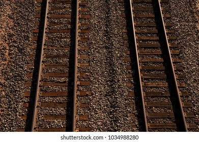 Image of weathered railroad tracks from above