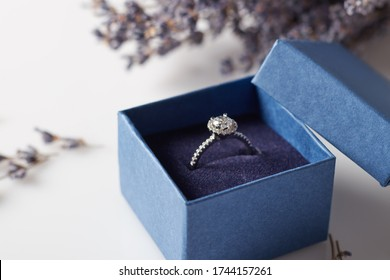 Image of wedding rings in a blue gift box. Beautiful rings in a blue box with delicate flowers. - Shutterstock ID 1744157261