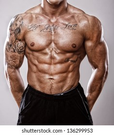 Image of well trained tattooed male body