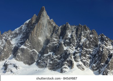 Image of the west-face of the Petit Dru summit (3733m) in Mont Blanc Massif. This summit together with the Grand Dru (3754m) form the Aiguille du Dru which is an iconic summit in this massif.