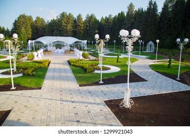 Image of the white wedding pavilion among forest