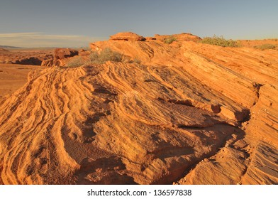 Image of wind and sand ground rock face in the Arizona Desert