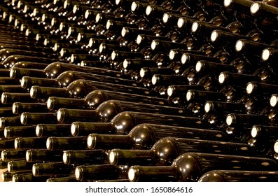 Image of wine bottles in an underground tunnel for aging wine.