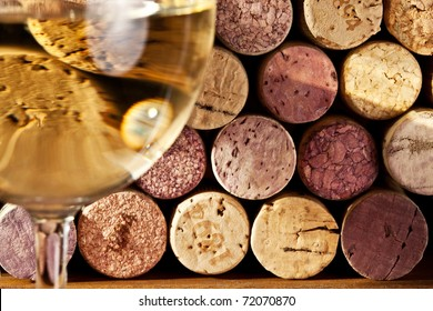 Image of wine corks through a glass of white wine.