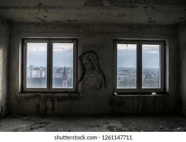 Image of a woman in an abandoned room between two windows