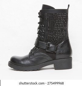 Image of woman black leather boot