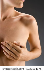 An image of woman covering her breast