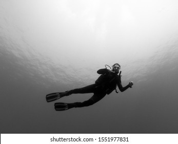 Image of a woman diver enjoying a dive in the waters of the Canary Islands. Diving sport