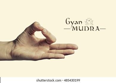 Image of woman hand in gyan mudra. Gesture is  isolated on toned background.