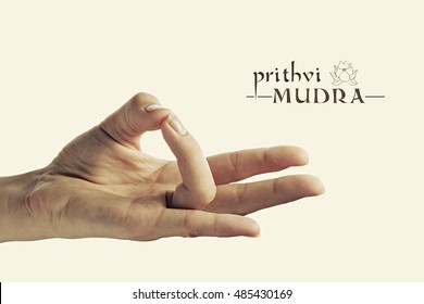 Image of woman hand in Prithvi mudra. Gesture is  isolated on toned background.