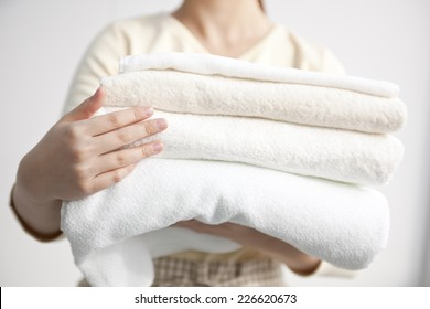 Image of a woman holding a towel