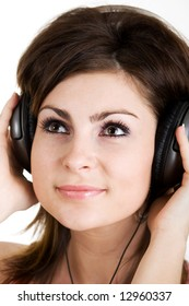 An image of woman listening to music