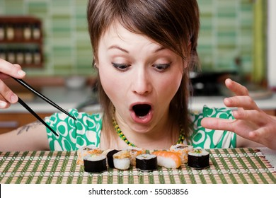 An image of a woman looking at sushi