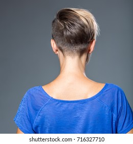 Image of woman with short hairstyle, view from behind. Haircut. Hairstyle