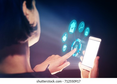 Image of a woman with a smartphone in her  hand. She makes transactions with real estate using her gadget.