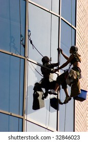 Image of woman washing a window