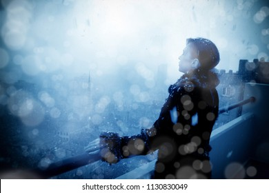 an image of a woman while snowing in winter time
