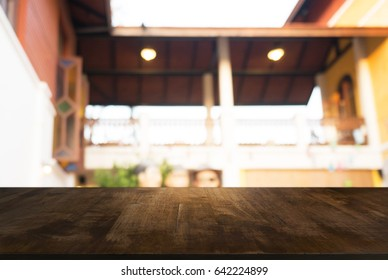 Image of wood table in front of abstract blurred background of coffee shop lights. can be used for display or montage your products.Mock up for display of product.