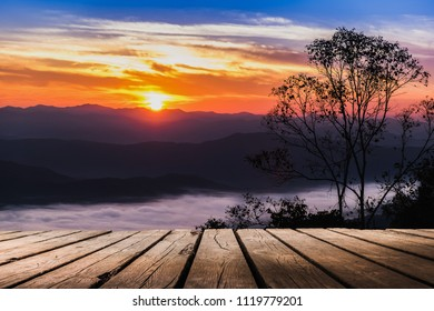 image of wooden balcony in front of Sunrise sky background at Doi Samer Dao in Si Nan National Park, Nan province, Thailand
