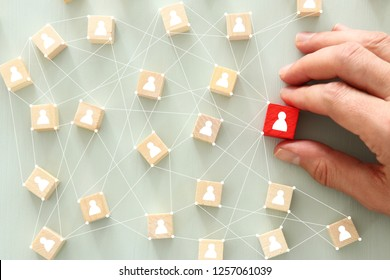 image of wooden blocks with people icon over mint table,building a strong team, human resources and management concept - Image