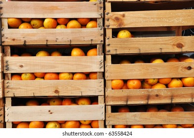 Image of wooden crates full of oranges.