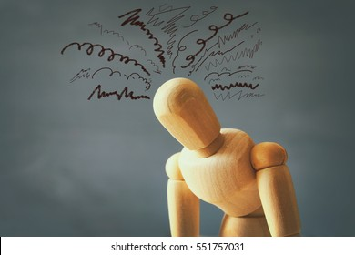 image of wooden dummy with worried stressed thoughts. depression, obsessive compulsive, adhd, anxiety disorders concept