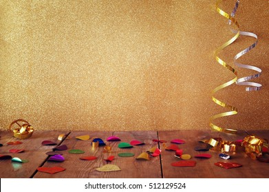 Image of wooden table with colorful confetti