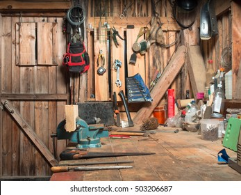 Image of a wooden table with a vise, and set them on the board against lying and hung on the walls of instruments inside the workshop rooms