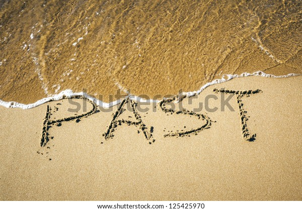 An image of a word in the sand: PAST