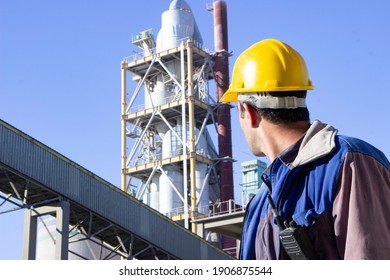 Image of worker working in cement factory